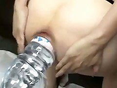 Evian bottle inserted in pussy