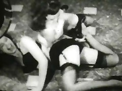Vintage: Betty Page and Lucy Kraven posing and wrestling