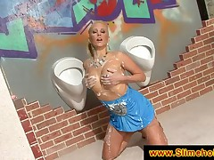 Blonde slurping jizz at the gloryhole