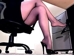 Sexy pantyhose legs and peeptoe mule dangle