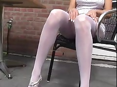 Hot blonde teases in white pantyhose