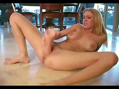 Allison Pierce with a big toy in the kitchen