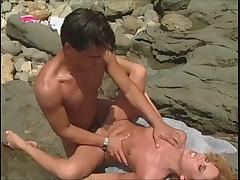 Allysin Chaynes atop the beach