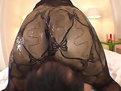 Dominant asian girl with oiled bodystocking