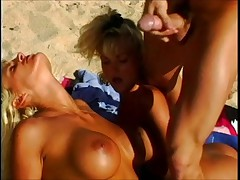 Stacey Valentine, Dawn Burning, and Vince Voyer on the beach