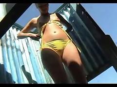 Voyeur shows girls changing at beach