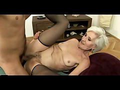 Grey Haired Granny in Stockings Gets Cum superior to before her Soft Pussy