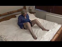 Granny in Fishnets on a Bed