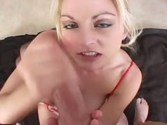 Luscious golden haired milf gives a good wank