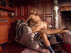 Blonde with snake tattoo on her back gets fucked