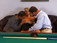 Young blonde girl is in a threesome