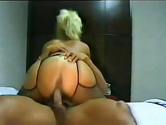 Blonde in mask bends over and makes love