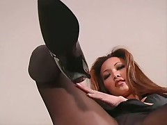Asian in sultry pantyhose showing off