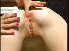 Fist fucking a mature pussy outdoors