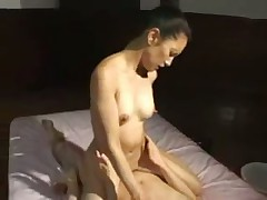 Japanese girl sucking a cock