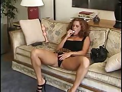 Beauty in short skirt toys her pussy