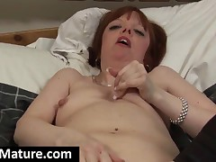 Stockinged Mature Bitch Screwing A Large Dildo