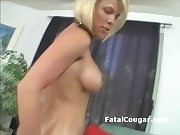 Blonde shorthair cougar shows her shaved pussy and teases for the camera
