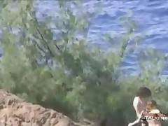 Lindsay Lohan - Lindsay Lohan Slowly Climbs Down A Sloping Cliffside Near Some Beach In This Paparaz