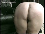 Nun slave with her dress up and panties down sitting on the floor is spanked on her ass by priest