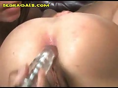 Domm Girl Shoves A Vibrator On Blondes Ass