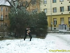 In Cold Winter This Busty Dame Pees In Public While She Arouses Her Boobs!