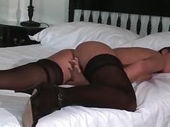 Brunette In Stockings Pleasuring Twat In Bed