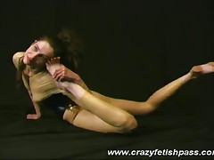 Rubber Babe Spreading Her Legs And Streching Wide Pussy