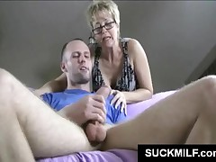 Short Haired Mature Bitch In Glasses Gives POV Blowjob