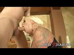 Big Tit Tattooed Slut April Vain Sucks And Fucks A Huge Cock