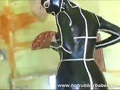 Hot Rubber Babe In Her Costume Teasing And Squizing
