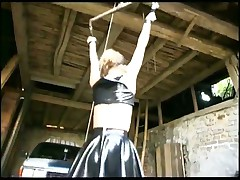 Wonderful tied up girl in short leather skirt goin