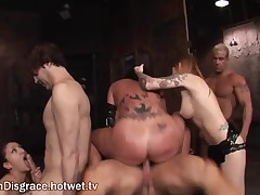 A Fierce Brunette Dominatrix Fucks Her Pet During A Hot Bondage Party