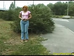 Naughty Lady Releases Her Rich Stream Of Pee Next To A Bush With Cars Passing By
