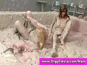 Wam girls having a mud wrestling fight