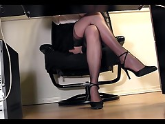 Under Desk View Of A Secretary Masturbating In Heels And Stockings