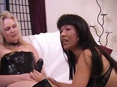 Asian lesbo rides strap on