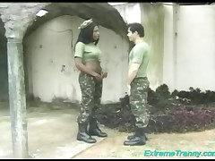 Chocolate Army Tranny Orders A Soldier To Suck Her Boner Just Before Drilling Him In The Ass Hole!