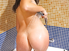 Watch Cheryl strip tease and rub her body down with lotion and whip cream and other kitchen goodies before showering off.