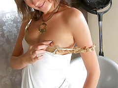 Glamorous Teen Nata plays dress up and then finger fucks her petite pussy after play time.