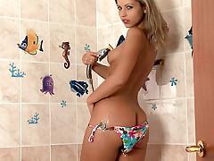 Hot bikini bodied babe Jenni strips nude and then showers her tan body while rubbing herself.