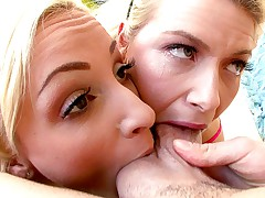 Two beautiful blondes suck every inch of performer's cock.