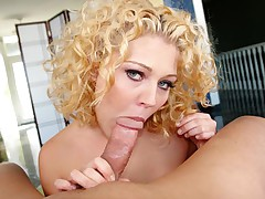 Blonde slut with curly hair sucks on your big wet hard cock!