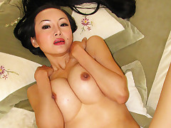 This asian milf with extra long hair gets fucked on bed