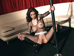 Tera Patrick is doing a pole dance dressed in fishnet