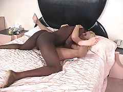 Blonde riding huge thick cock in interracial action video