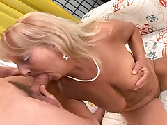 Blonde sexy granny is satisfied by a young cock and cream