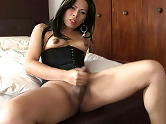 Tight bodied tranny plays with her ass and strokes her cock!
