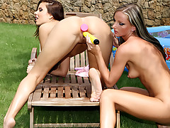 Two cute horny girls having a hot outdoor fucking session !
