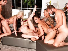 couples share in a no holes barred fucking extravaganza!